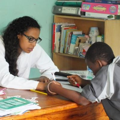 A local child is treated by a student doing a Speech Therapy internship abroad in Africa.